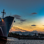 Ship moored at sunset
